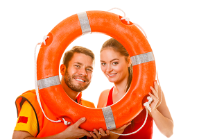 """wearing a lifevest and holding a life buoy"""
